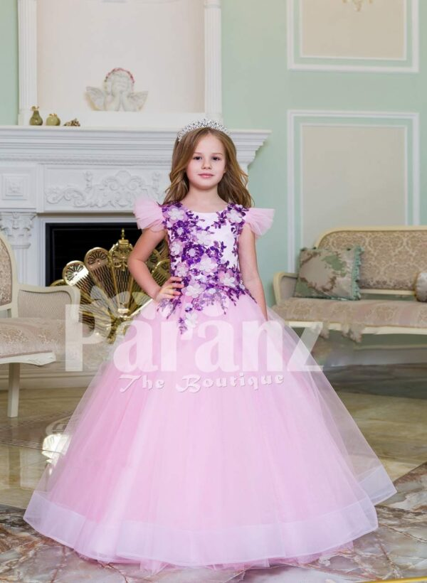 Beautiful floor length light pink baby gown with floral appliquéd bodice and tulle skirt
