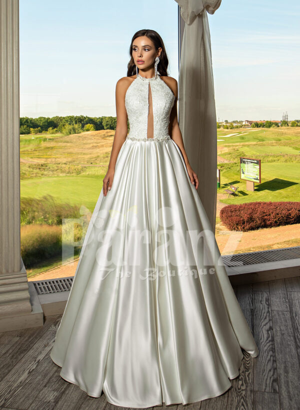 Closed neck and open back flared satin wedding gown with tulle skirt underneath