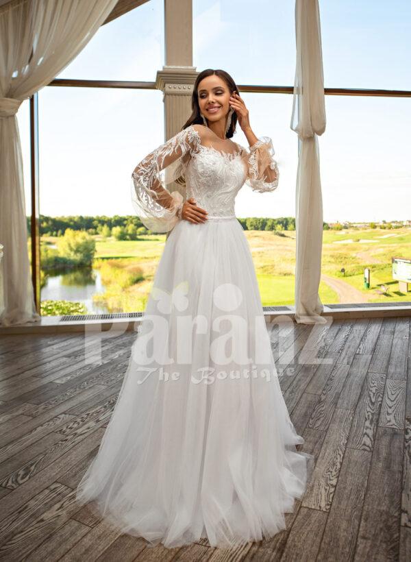 Elegant white soft tulle skirt wedding gown with full sleeve royal bodice
