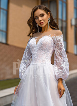 Floor length stunning white off-shoulder Arabian princess style wedding tulle gown close view