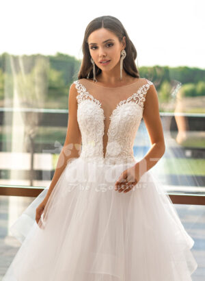 Multi-layer flared tulle skirt pearl white wedding gown with glam bodice close view