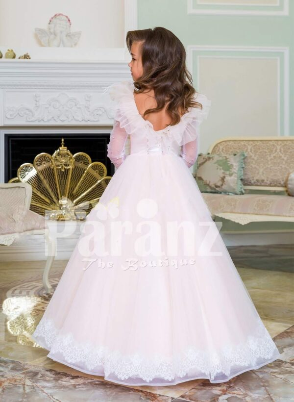 Powder pink floor length baby gown dress with full sheer sleeves and ruffle-feather bodice Back side view