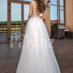 White floor length tulle wedding gown with glitz glam bodice back side view