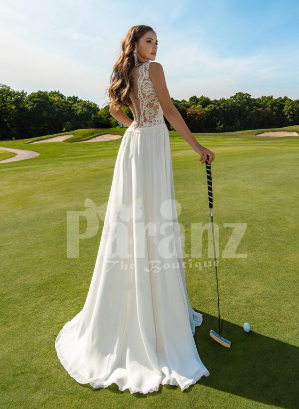 Women's all white super glam wedding tulle gown with elegant lacy bodice back side view