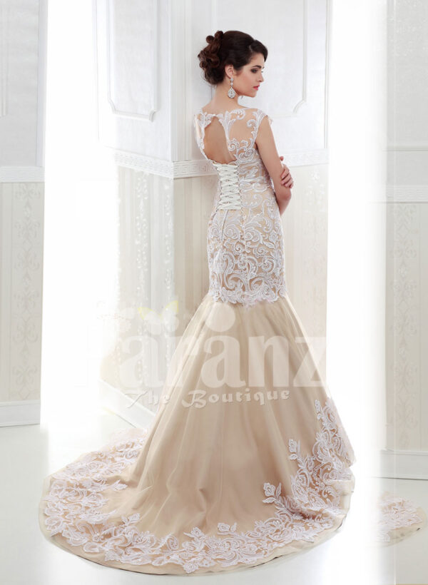 Women's beautiful mermaid style tulle skirt wedding gown in beige back side view
