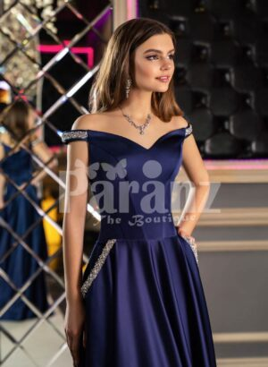 Women's elegant navy blue smooth satin evening gown with off-shoulder bodice