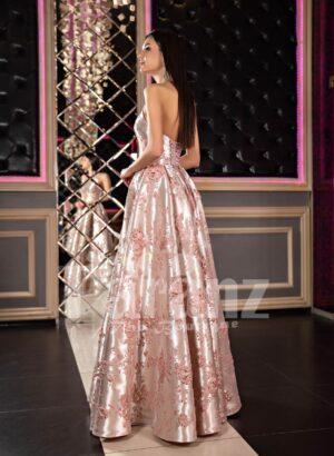 Women's floor length side slit glossy rich satin rosette appliquéd evening party dress side view