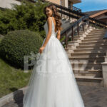Women's glam white sleeveless wedding tulle gown with royal bodice back side view