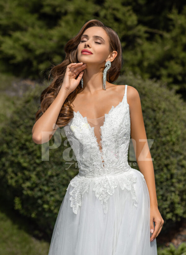Women's glam white sleeveless wedding tulle gown with royal bodice close view