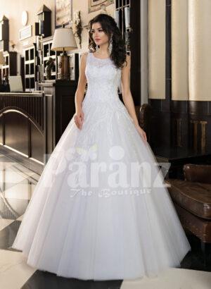 Women's milk-white high volume tulle skirt wedding gown with pleasing bodice