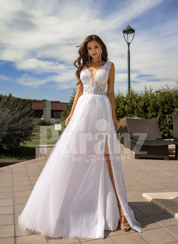 Women's pearl white side slit tulle wedding gown with stunning lacy bodice