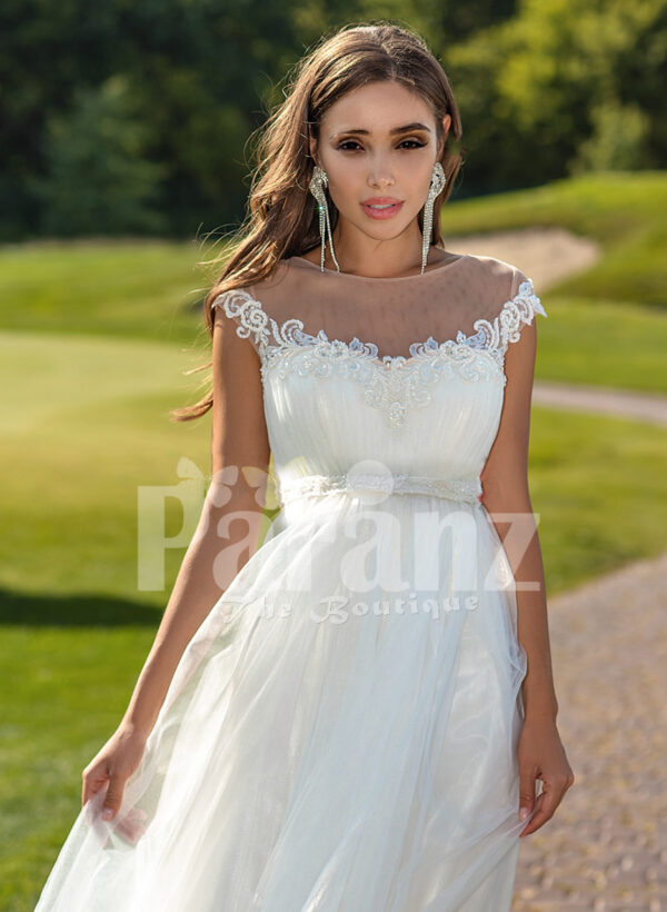 Women's sleeveless elegant white flared high volume tulle wedding gown close view