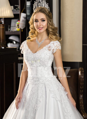Women's super stylish and elegant white wedding tulle gown with lacy bodice close view