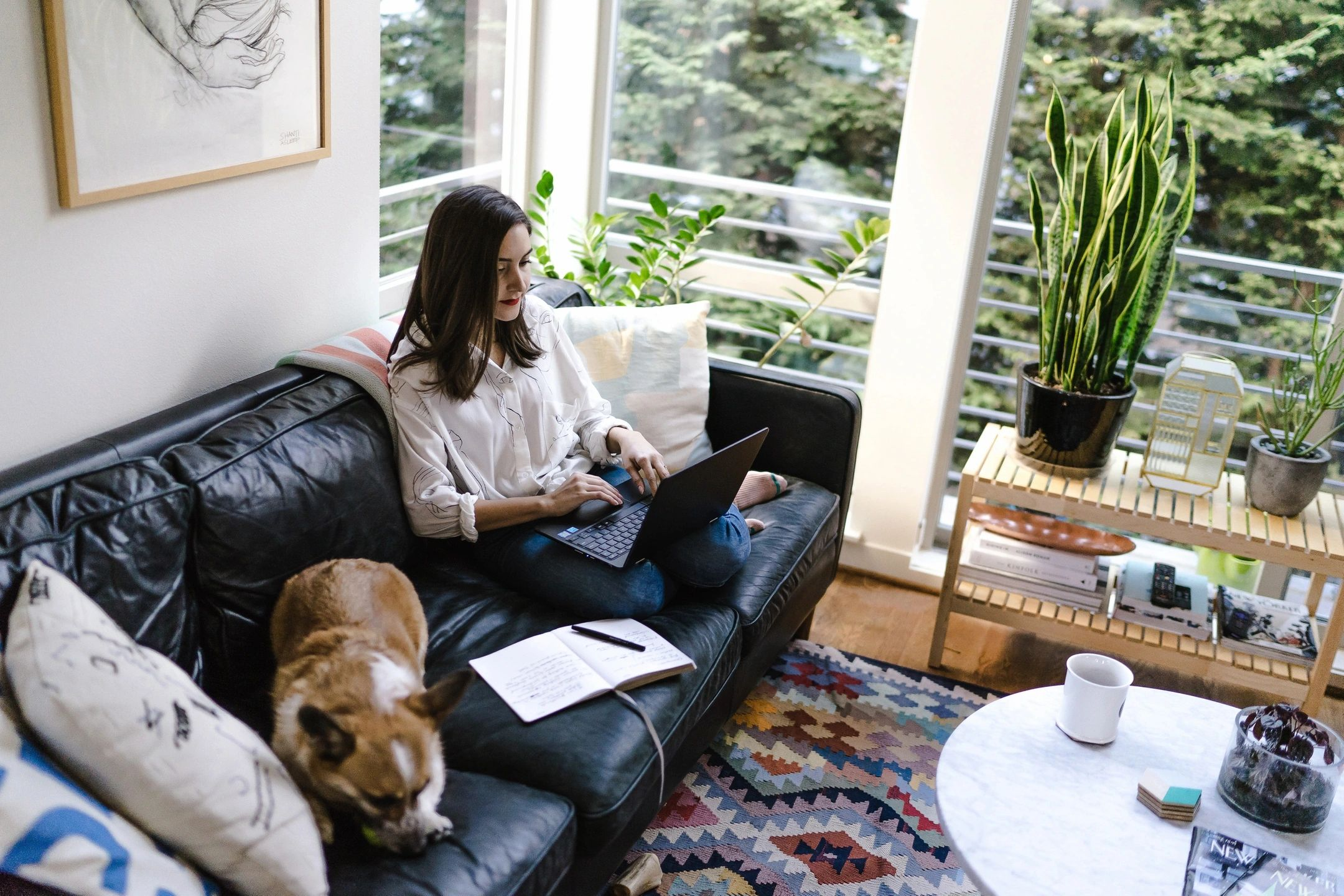 woman working from home on the couch