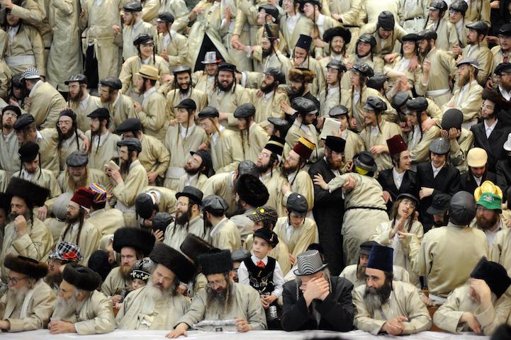 Ultra-Orthodox Jews celebrate the Purim holiday in the ultra-orthodox Mea Shearim neighborhood in Jerusalem