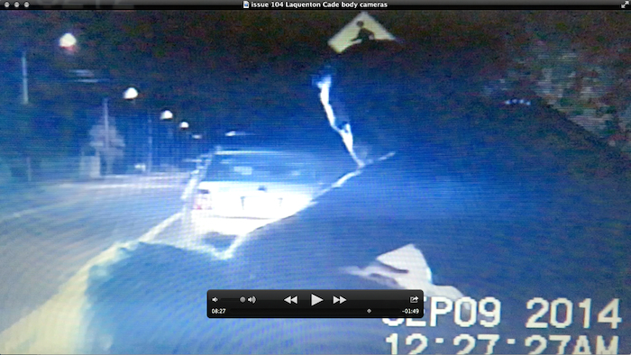Officer looking at dashcam