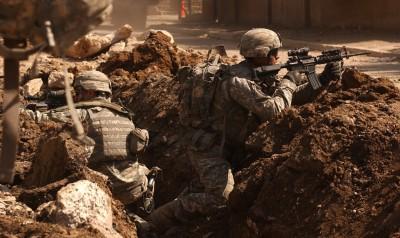US_Army_soldiers_in_a_firefight_near_Al_Doura,_Baghdad public domain via Wikimedia