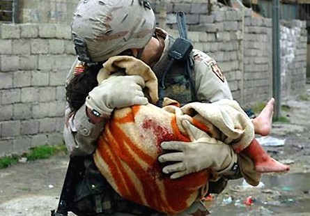 Afghanistan-US-soldier-holding-dead-baby Public Domain Via Wikimedia