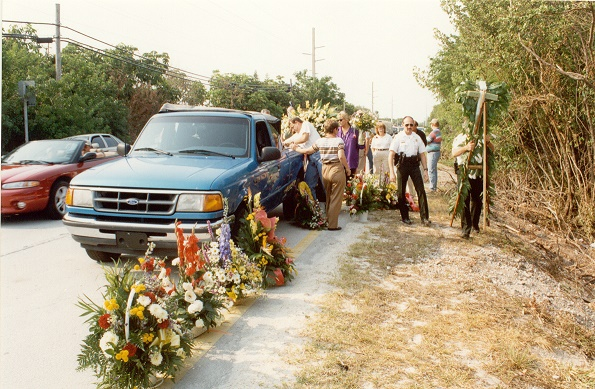 Members of the Sheriff's Office and others who knew Deputy Alexander set up a roadside memorial for him.