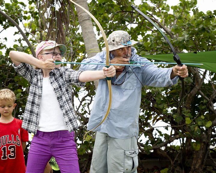 Student Maddison Bock practices bow and arrow target shooting with instructor Lee Starling during Starling's Key West Art & Historical Society Native American Craftsman ArtCamp! last week.