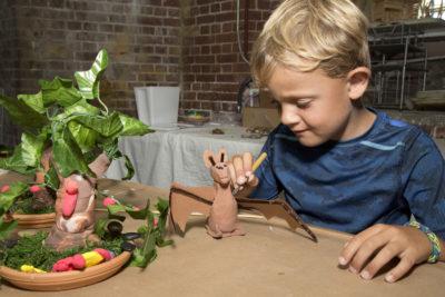Creative Kids Participate in Clay Workshop