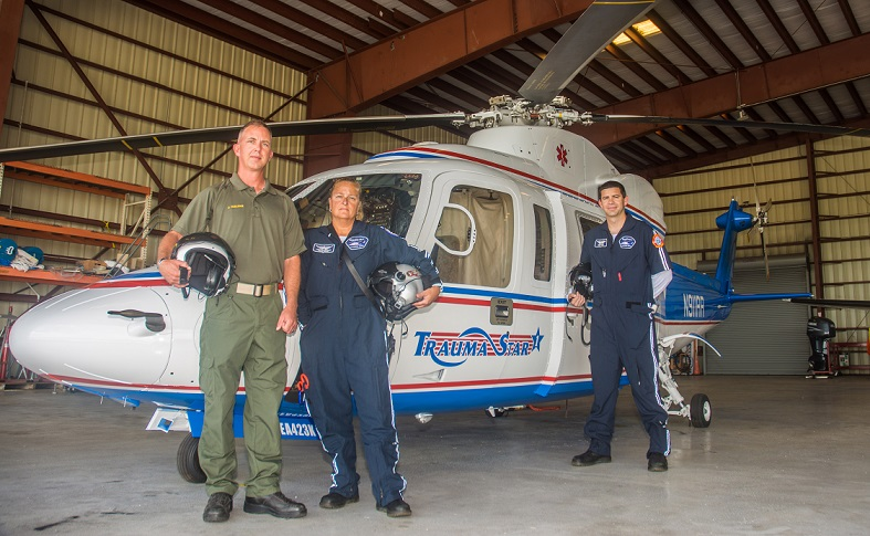 Pilot Jim Mullenix, Flight Nurse Lynda Rusinowski and Flight Medic Evan Griffin stand in front of the newly acquired Trauma Star helicopter at Trauma Star headquarters in Marathon. The 2006 aircraft arrived last week.