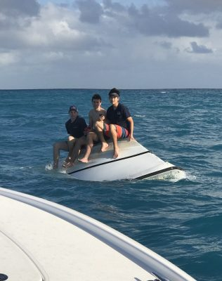 Three Teens Saved from Capsized Vessel