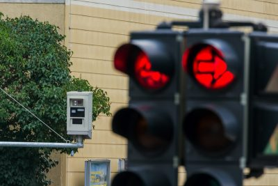 Drivers Nabbed by Red Light Cameras Want Their Money Back