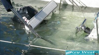 Woman Raises Sunken Boat With a Bucket