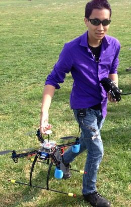 Chris Vo holds a drone at the DC DUG Fly-in.