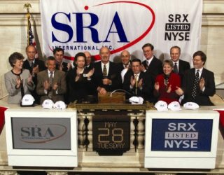 Dr. Ernst Volgenau rings the opening bell of the New York Stock Exchange of SRA's initial public offering.