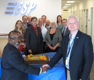 SSG President and CEO Calvin Mitchell, left, shakes hands with ESP President and CEO Doug Fouser