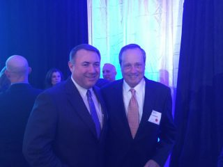 NCI Inc. CEO Brian Clark and Paul Lombardi (NCI Inc. Board of Directors member)