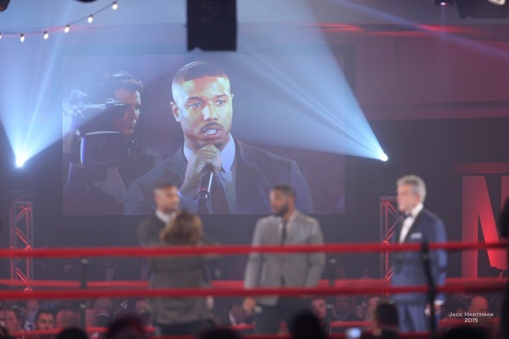 Actor Michael B. Jordan (speaking) and director Ryan Coogler from the upcoming movie CREED in the ring with announcer Michael Buffer to present commemorative robe to Fight For Children. Photo credit Jack Hartzman/Fight For Children