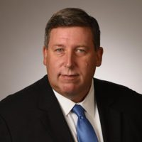 John P. Woods Vice President & DHS Client Executive CACI International, Inc.