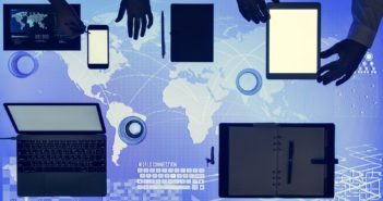 Digital devices on cyber space table