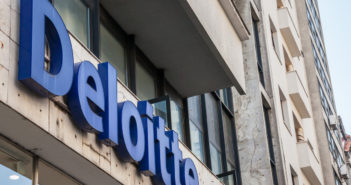 """Picture of Deloitte sign with their logo on a buisiness building in Belgrade, Serbia. Deloitte Touche Tohmatsu is a multinational professional services network, one of the """"Big Four"""" accounting organizations and the largest professional services network in the world by revenue and number of staff and collaborators"""