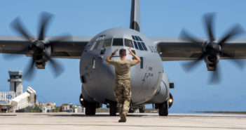 Staff Sgt. Keaton Truman, 36th Mobility Response Squadron mobility crew chief, marshals in a C-130J Super Hercules with the 347th Airlift Wing from Yokota Air Base, Japan, at the Saipan International Airport, Commonwealth of the Northern Mariana Islands, Nov. 10, 2018. Service members from Joint Region Marianas and U.S. Indo-Pacific Command are providing Defense Department support to the CNMI's civil and local officials as part of the FEMA-supported Super Typhoon Yutu recovery efforts.