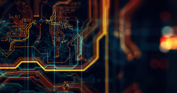 Abstract technological background made of different element printed circuit board. Depth of field effect and bokeh.