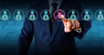 Corporate security manager identifies a potential insider threat in a line-up of eight white collar workers. Hacker or spy icon lights up purple. Cybersecurity and human resources challenge concept. (Corporate security manager identifies a potential i