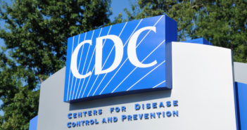 Atlanta, Georgia, USA - August 28, 2011: Close up of entrance sign for Centers for Disease Control and Prevention. Sign located near the 1700 block of Clifton Road in Atlanta, Georgia, on the Emory University campus. Vertical composition.