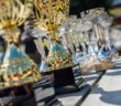 Gold and silver trophies on a wooden table