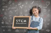 STEM Education on school teacher's classroom chalkboard with smart girl kid student holding blackboard for science, technology, engineering, mathematics educational learning system