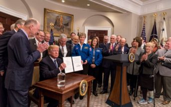 In this file photo from Dec. 11, 2017, President Donald Trump signs Space Policy Directive -1. Official White House photo: Joyce N. Boghosian