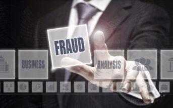 Businessman pressing an Fraud concept button.