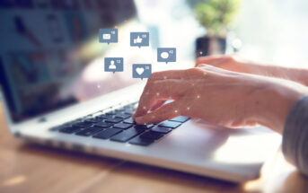 Businesswoman hands using laptop with icon social media and social network, Marketing concept.