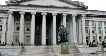 Bronze statue of Albert Gallatin (1761-1849), the longest serving US Secretary of Treasury, stands before the Treasury Department in Washington, DC.