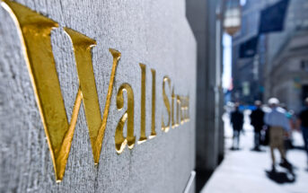 golden Wall Street sign in the downtown financial district of New York, USA