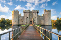 Bodiam, United Kingdom - October 3, 2017: Moated castle near Robertsbridge in East Sussex, England as seen at sunrise. It was built in 1385 to defend the area against French invasion during the Hundred Years' War. (Bodiam, United Kingdom - October 3,