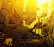 A digital mainboard, motherboard or circuitboard, is lit with a golden light and shines.